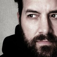 Image of Bob Schneider linking to their artist page due to link from them being at the top of the main table on this page