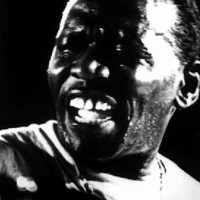 Image of Elvin Jones linking to their artist page due to link from them being at the top of the main table on this page