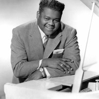 Image of Fats Domino linking to their artist page due to link from them being at the top of the main table on this page