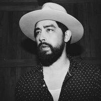 Image of Jackie Greene linking to their artist page due to link from them being at the top of the main table on this page