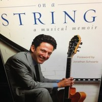 Image of John Pizzarelli linking to their artist page due to link from them being at the top of the main table on this page
