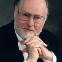 Image of John Williams linking to their artist page due to link from them being at the top of the main table on this page