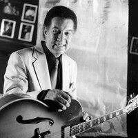 Image of Kenny Burrell linking to their artist page due to link from them being at the top of the main table on this page