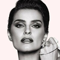 Image of Nelly Furtado linking to their artist page due to link from them being at the top of the main table on this page