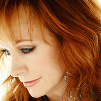 Image of Reba McEntire linking to their artist page, present due to the event they are headlining being at the top of this page