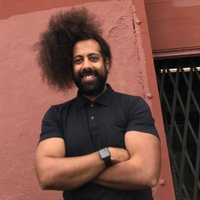 Image of Reggie Watts linking to their artist page due to link from them being at the top of the main table on this page
