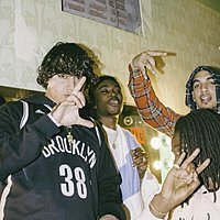 Image of Shoreline Mafia linking to their artist page due to link from them being at the top of the main table on this page