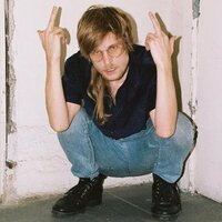 Image of Slug Christ linking to their artist page due to link from them being at the top of the main table on this page