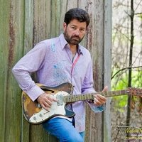 Thumbnail for the Acoustic Blues link, displaying genre artist Tab Benoit