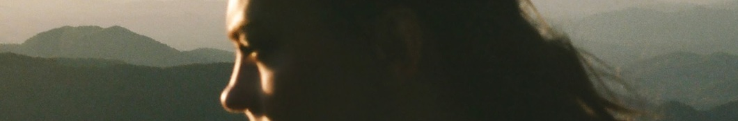 Large banner image of Angel Olsen linking to their artist page due to them being the most commonly displayed artist on this title page