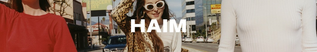 Large banner image of HAIM linking to their artist page due to them being the most commonly displayed artist on this title page
