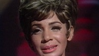 Image of Shirley Bassey linking to their artist page due to link from them being at the top of the main table on this page